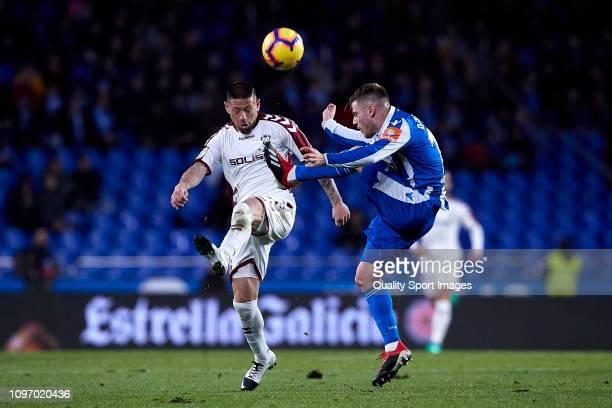 Diego Caballo of Deportivo de La Coruna competes for the ball with Carlos Acuna of Albacete Balompie the La Liga 123 match between Deportivo de La...