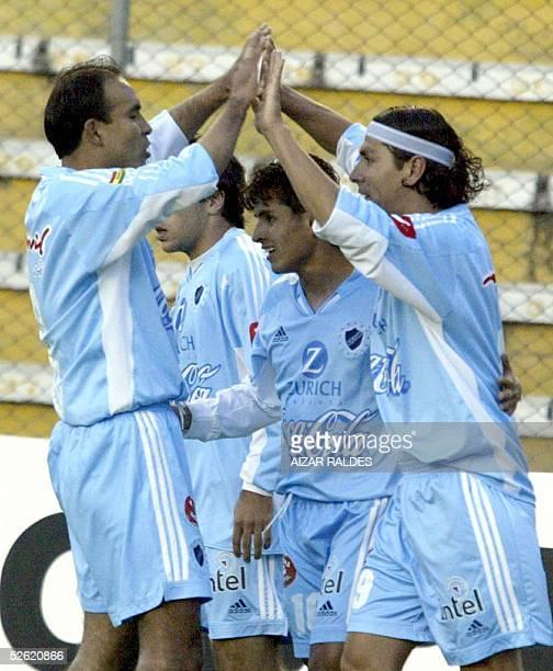 Diego Cabrera del Bolivar es felicitado tras convertir un para su equipo por sus companeros Marco Sandy y Matias Fisher y Daner Pachi el 12 de abril...