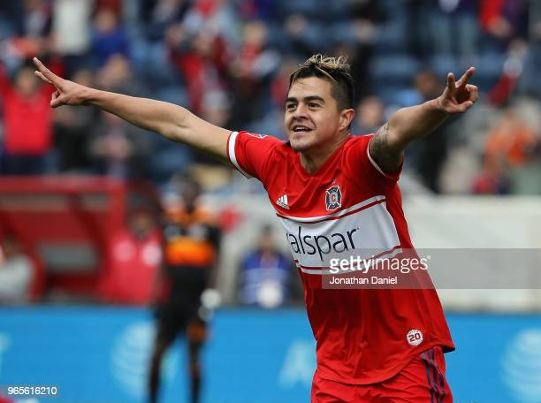 Diego Campos of the Chicago Fire celebrates a goal against the Houston Dynamo at Toyota Park on May 20 2018 in Bridgeview Illinois The Dynamo...