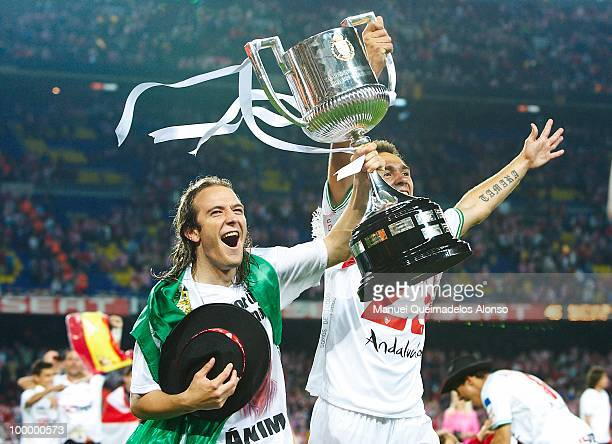 Diego Capel of Sevilla celebrates with his teammate Lolo after winning the Copa del Rey final between Atletico de Madrid and Sevilla at Camp Nou...