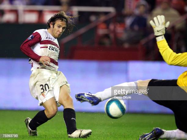 Diego Capel of Sevilla has his shot at goal blocked by Cernea of Steaua Bucharest in the second leg of their UEFA Cup round of 32 match between...