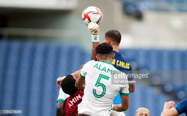 Diego Carlos of Brazil and Amin Bukhari of Saudi Arabia battle for the ball during the Men's Group D match between Saudi Arabia and Brazil on day...