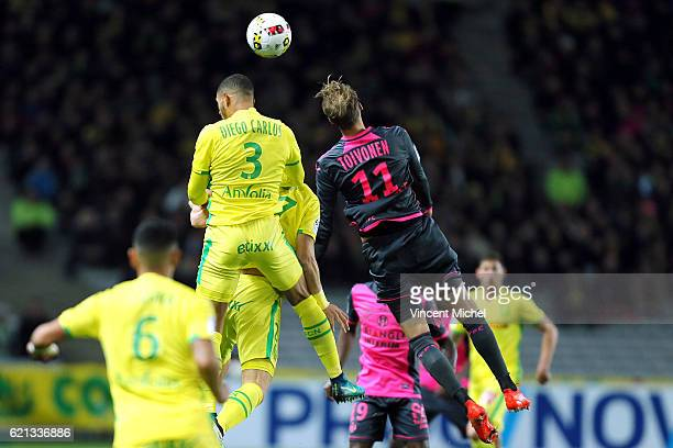 Diego Carlos of Nantes and Ola Toivonen of Toulouse during the Ligue 1 match between Fc Nantes and Toulouse Fc at Stade de la Beaujoire on November 5...