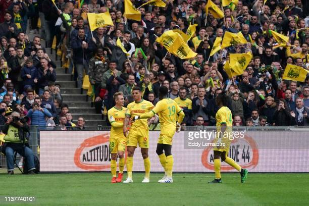 Diego Carlos of Nantes celebrates with teammate after scoring a goal during the Ligue 1 match between Nantes and Paris Saint Germain at Stade de la...