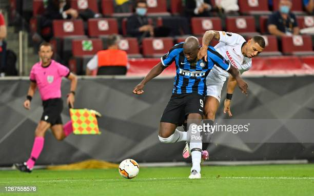 Diego Carlos of Sevilla FC and Romelu Lukaku of Inter Milan clash, leading to a penalty for Inter Milan and their team's first goal, scored by Romelu...
