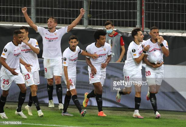 Diego Carlos of Sevilla FC and team mates celebrate their team's third goal an own goal scored by Romelu Lukaku of Inter Milan during the UEFA Europa...