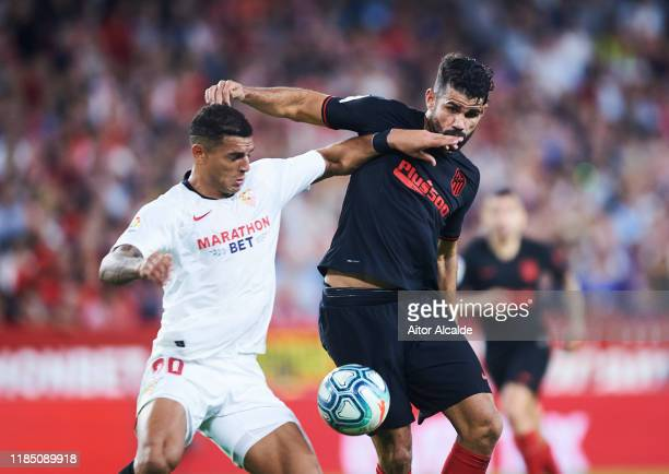 Diego Carlos of Sevilla FC duels for the ball with Diego Costa of Club Atletico de Madrid during the Liga match between Sevilla FC and Club Atletico...