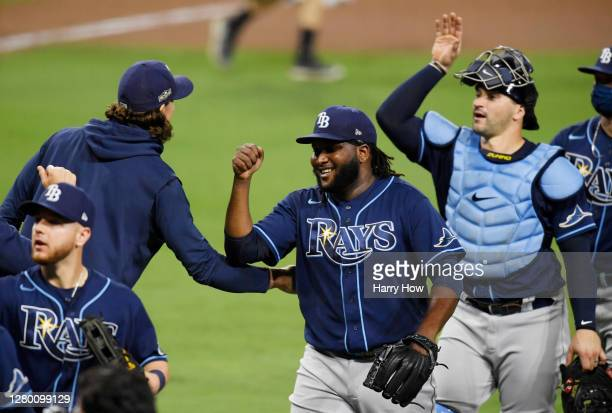 Diego Castillo of the Tampa Bay Rays celebrates a 5-2 win with teammates against the Houston Astros in Game Three of the American League Championship...
