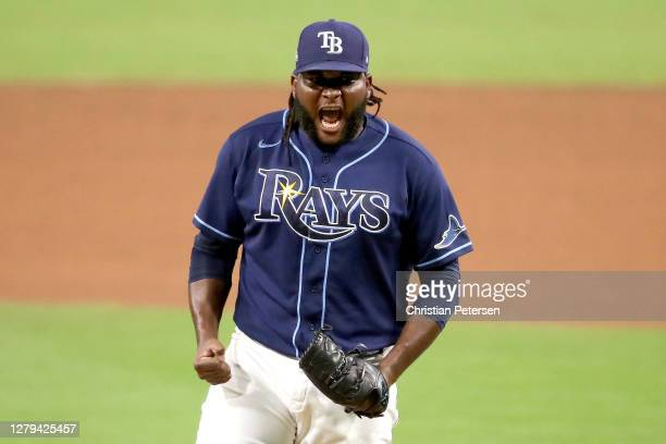 Diego Castillo of the Tampa Bay Rays celebrates after closing the game to give his team the 2-1 victory against the New York Yankees in Game Five of...