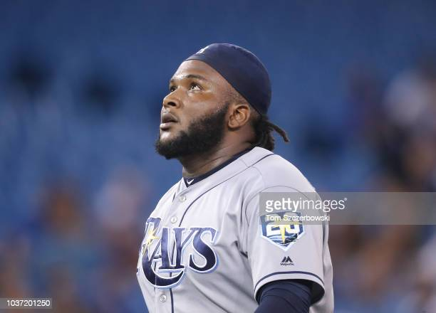Diego Castillo of the Tampa Bay Rays reacts as he walks off the mound after getting the last out of the eighth inning during MLB game action against...