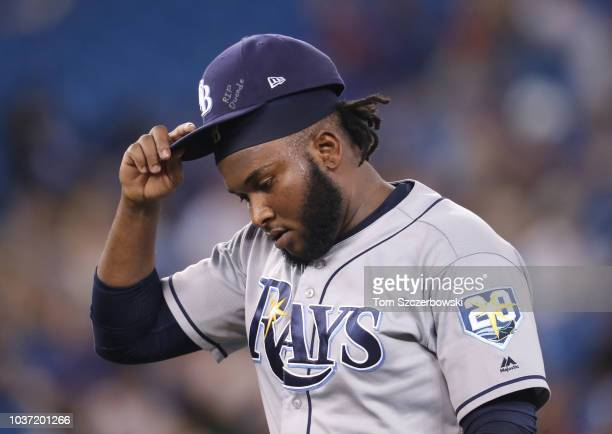 Diego Castillo of the Tampa Bay Rays walks off the mound after getting the last out of the eighth inning during MLB game action against the Toronto...