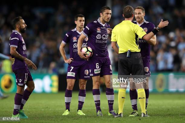 Diego Castro and Joel Chianese of the Glory watch on as Dino Djulbic and Rostyn Griffiths of the Glory make their point to referee Peter Green during...