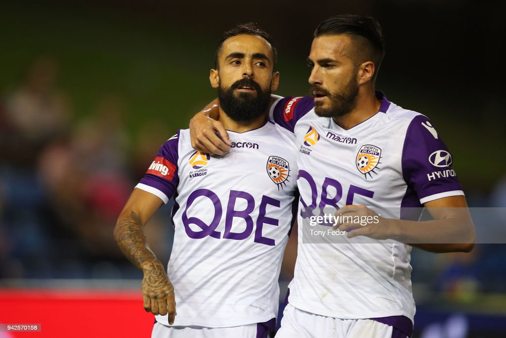 Diego Castro and Xavier Torres of the Glory celebrate a goal during the round 26 A-League match between the Newcastle Jets and the Perth Glory at McDonald Jones Stadium on April 6, 2018 in Newcastle, Australia.
