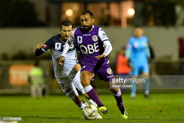 Diego Castro Gimenez of the Glory controls the ball against Kosta Barbarouses of the Victory during the FFA Cup round of 32 match between Perth Glory...