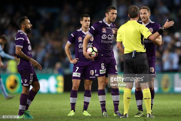 Diego Castro Joel Chianese Dino Djulbic and Rostyn Griffiths of the Glory argue with the referee Pweter Green after a Sydney FC goal during the...