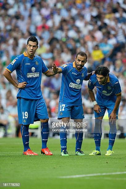 Diego Castro of Getafe CF gives instructions to his teammate Angel Lafita in company with Nicolas Ladislao alias Miku during the La Liga match...