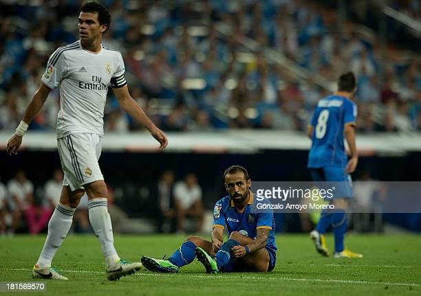 Diego Castro of Getafe CF sits on the ground after failing to score during the La Liga match between Real Madrid CF and Getafe CF at Estadio Santiago...