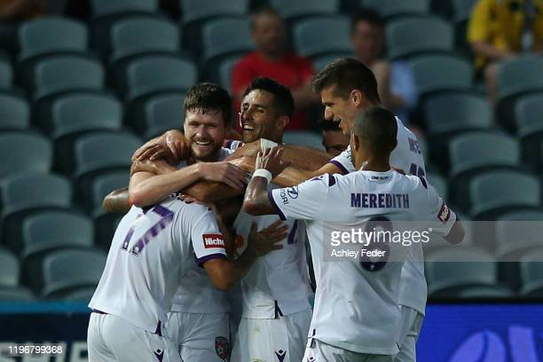 Diego Castro of Perth Glory celebrates his goal with team mates during the round 12 A-League match between the Central Coast Mariners and the Perth...