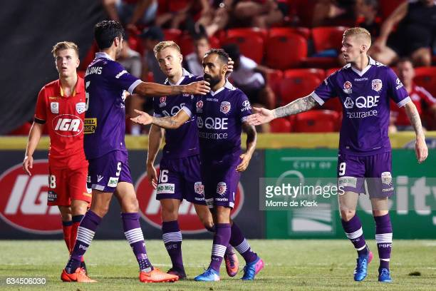 Diego Castro of Perth Glory celebrates with teammates after he scored a goal during the round 19 ALeague match between Adelaide United and Perth...
