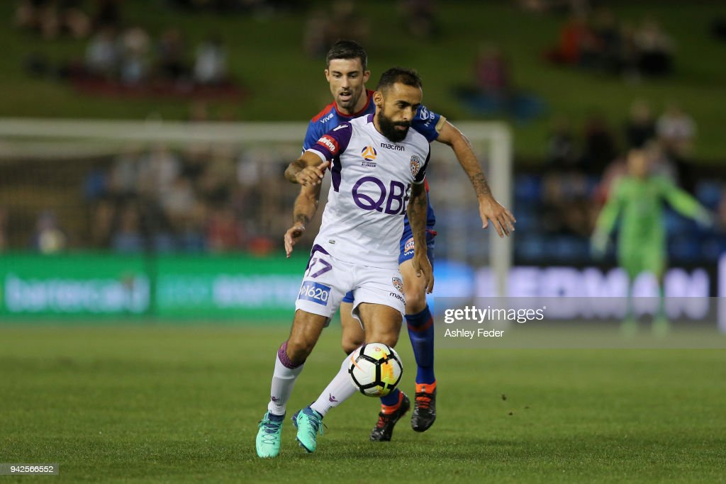 Diego Castro of Perth Glory is contested by Jason Hoffman of the Jets during the round 26 A-League match between the Newcastle jets and the Perth Glory at McDonald Jones Stadium on April 6, 2018 in Newcastle, Australia.