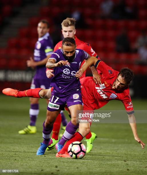 Diego Castro of Perth Glory is tackled by Isaas of Adelaide United during the round 25 ALeague match between Adelaide United and Perth Glory at...