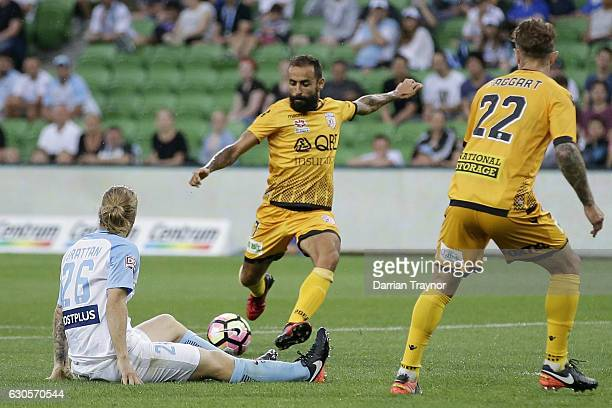 Diego Castro of Perth Glory scores during the round 12 ALeague match between Melbourne City and Perth Glory at AAMI Park on December 27 2016 in...