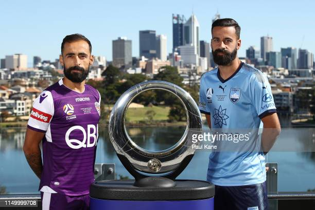 Diego Castro of the Glory and Alex Brosque of Sydney pose with the A-League Champions trophy during a media opportunity ahead of Sunday's A-League...