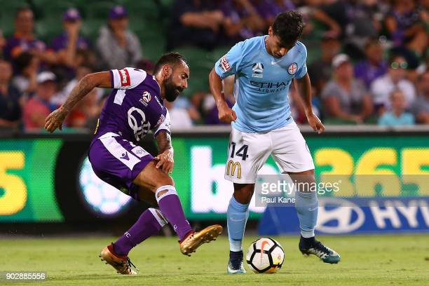 Diego Castro of the Glory and Daniel Arzani of Melbourne contest for the ball during the round 15 ALeague match between the Perth Glory and Melbourne...