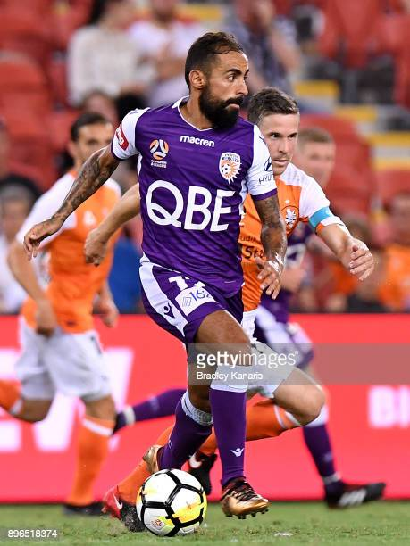 Diego Castro of the Glory breaks away from the defence during the round 11 ALeague match between the Brisbane Roar and the Perth Glory at Suncorp...