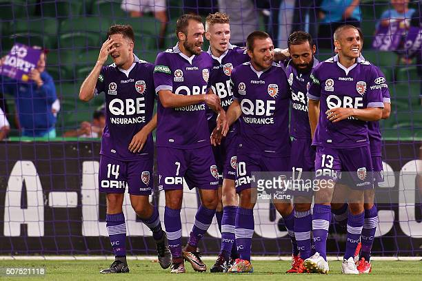 Diego Castro of the Glory celebrates a goal with team mates during the round 17 ALeague match between Perth Glory and Melbourne Victory at nib...