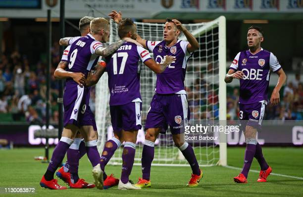 Diego Castro of the Glory celebrates after scoring their fourth goal with his teammates during the round 19 ALeague match between the Perth Glory and...