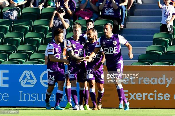 Diego Castro of the Glory celebrates with team mates after scoring during the round 18 ALeague match between the Perth Glory and the Western Sydney...