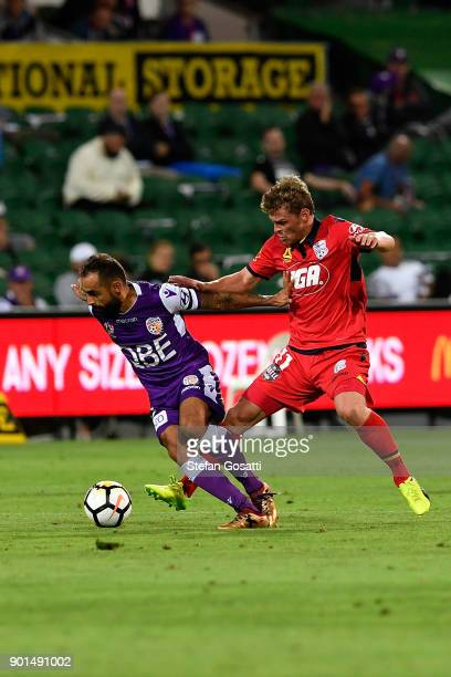 Diego Castro of the Glory compete for the ball against Johan Absalonsen of Adelaide during the round 14 ALeague match between the Perth Glory and...