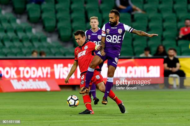 Diego Castro of the Glory competes for the ball against Isaias of Adelaide during the round 14 ALeague match between the Perth Glory and Adelaide...