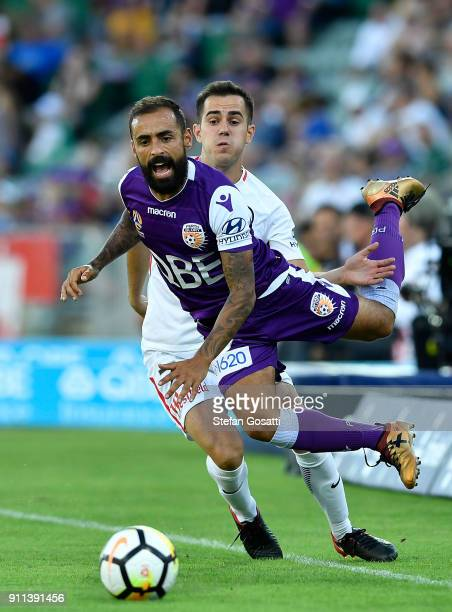 Diego Castro of the Glory competes for the ball against Steven Lustica of the Wanderers during the round 18 ALeague match between the Perth Glory and...