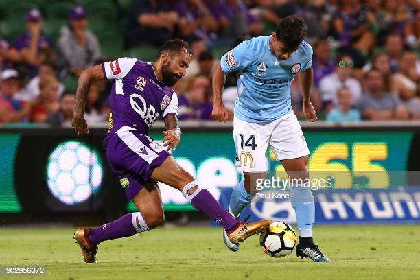 Diego Castro of the Glory controls the ball against Daniel Arzani of Melbourne during the round 15 ALeague match between the Perth Glory and...
