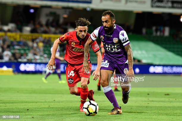 Diego Castro of the Glory controls the ball against Jordan O'Doherty of Adelaide during the round 14 ALeague match between the Perth Glory and...