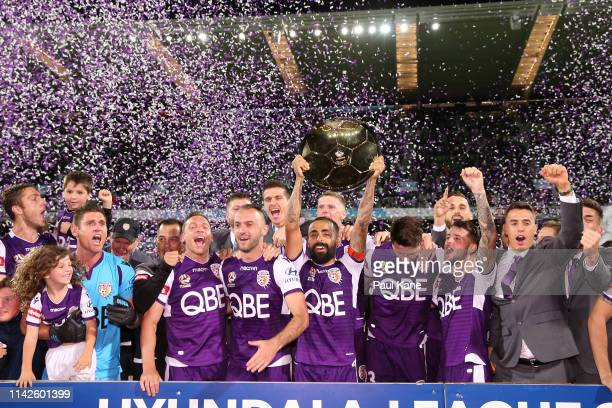 Diego Castro of the Glory holds the Premiers plate aloft after winning the round 25 ALeague match between the Perth Glory and the Newcastle Jets at...