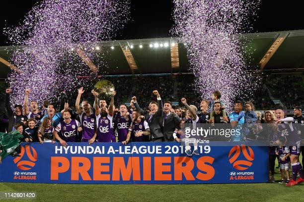 Diego Castro of the Glory holds the Premiers plate aloft with the team after winning the round 25 ALeague match between the Perth Glory and the...