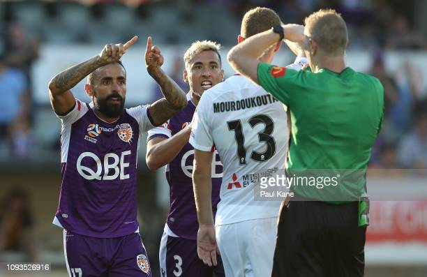Diego Castro of the Glory signals to Referee Kurt Ams for a VAR after scoring during the round 13 ALeague match between the Perth Glory and the...