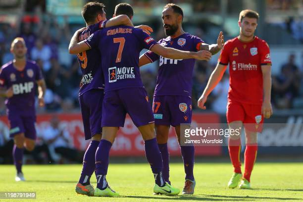 Diego Castro of the Perth Glory celbrates with Joel Chianese of the Perth Glory and Bruno Fornaroli of the Perth Glory after a goal during the round...