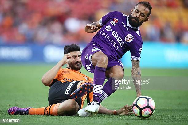 Diego Castro of the Roar and Joseph Katebian of the Glory compete for the ball during the round four ALeague match between the Brisbane Roar and...