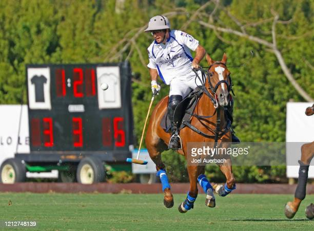 Diego Cavanagh of Valiente brings the ball up field against Richard Mille during The Palm Beach Open on March 15 2020 at the Grand Champions Polo...