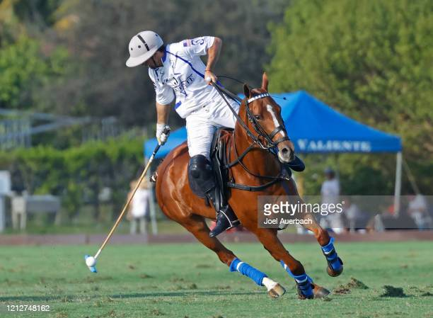 Diego Cavanagh of Valiente reaches back to play the ball against Richard Mille during The Palm Beach Open on March 15 2020 at the Grand Champions...