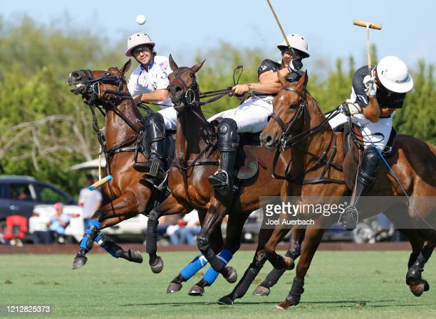 Diego Cavanagh of Valiente xplays the ball past Camilo Castagnola and Barto Castagnola of Richard Mille during The Palm Beach Open on March 15 2020...
