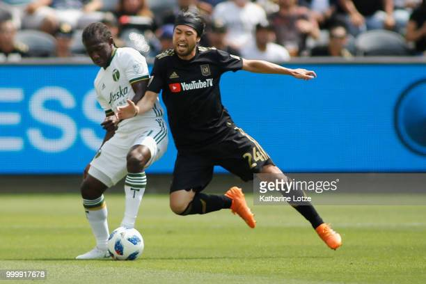 Diego Chara of the Portland Timbers and Lee Nguyen of the Los Angeles Football Club battle for control of the ball at Banc of California Stadium on...