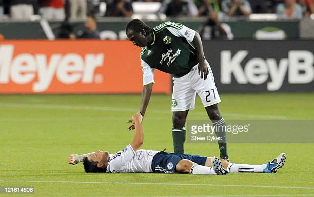 Diego Chara of the Portland Timbers shakes hands with John Thorrington of Vancouver FC after their game at JeldWen Field on August 20 2011 in...