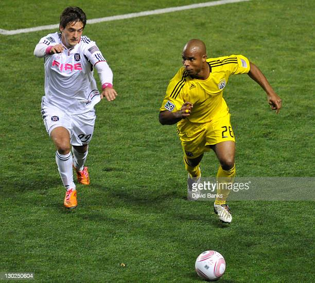 Diego Chaves of the Chicago Fire and Julius James of the Columbus Crew vie for the ball during an MLS match on October 22 2011 at Toyota Park in...