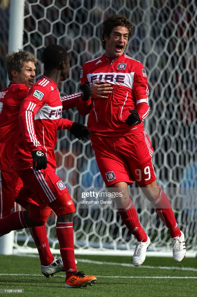 Diego Chaves #99 of the Chicago Fire celebrates a penalty kick goal with teammates (L-R) Logan Pause #12 and Patrick Nyarko #14 against Sporting Kansas City during an MLS match at Toyota Park on March 26, 2010 in Bridgeview, Illinois.