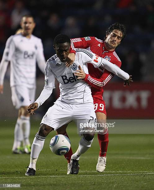 Diego Chaves of the Chicago Fire tires to slow Gershon Koffie of the Vancouver Whitecaps FC during an MLS match at Toyota Park on May 7 2011 in...